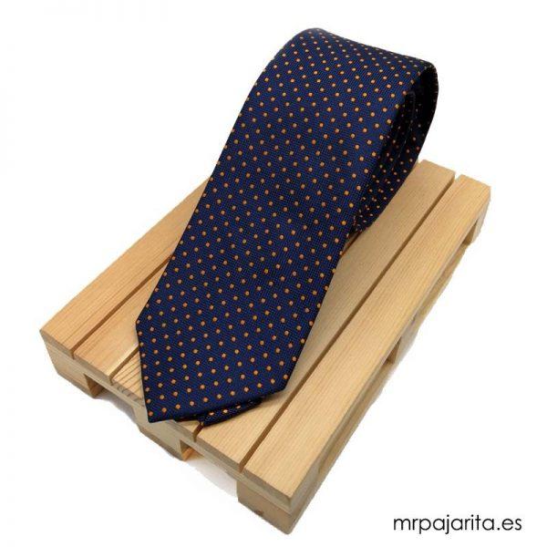 Corbata azul marino con topos naranjas